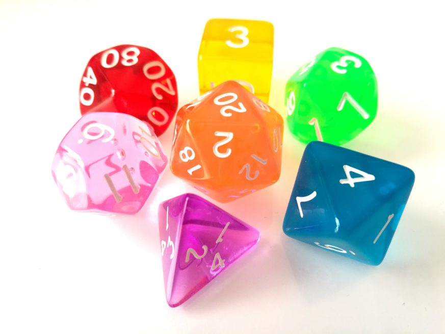 Close-Up Of Colorful Dice Over White Background